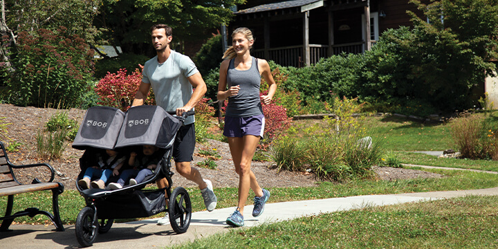 couple on a walk pushing stroller